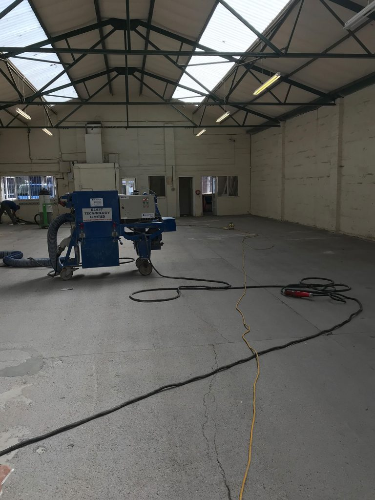removing factory floor paint