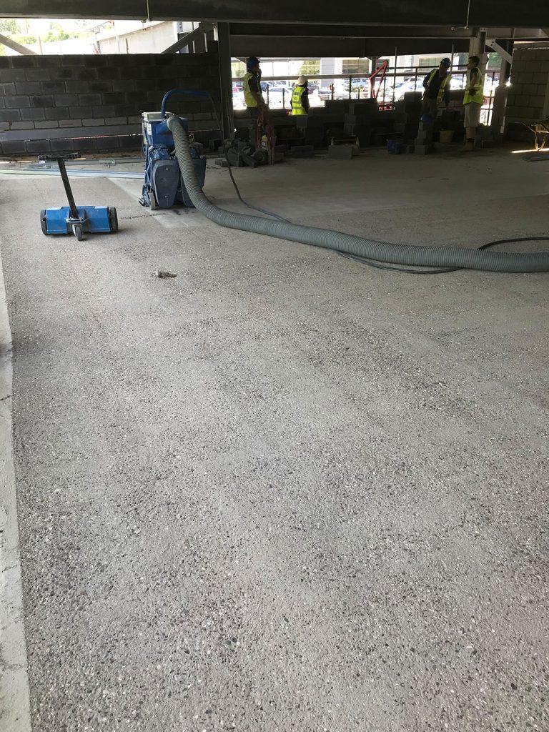sand blasting of an industrial floor