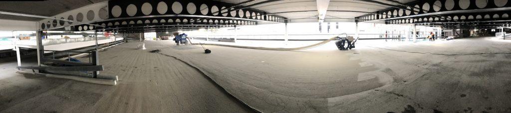 wide shot of warehouse floor dust free shot blasting