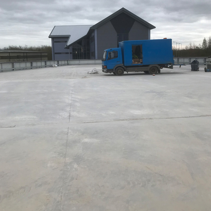 cleaning the surface of a concrete car park