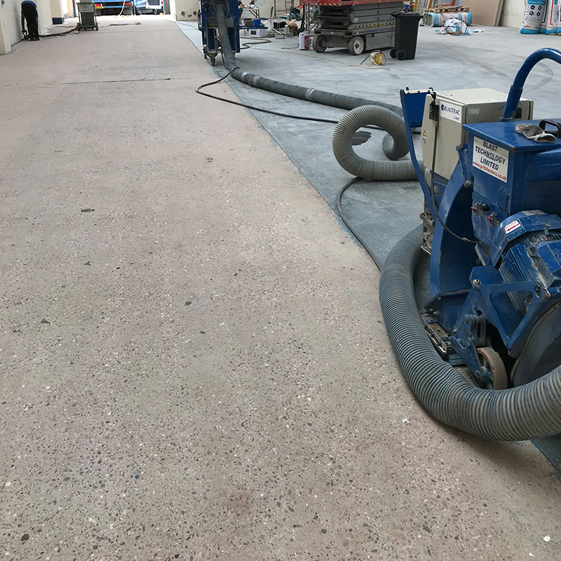 resurfacing old concrete floor in a warehouse